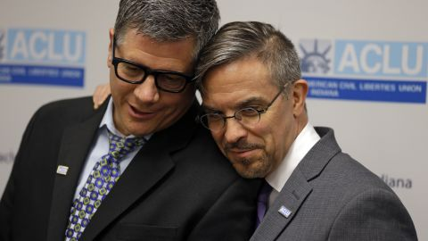 Rob MacPherson, right, and his husband, Steven Stolen, hug during a news conference at the American Civil Liberties Union in Indianapolis on October 6, 2014.