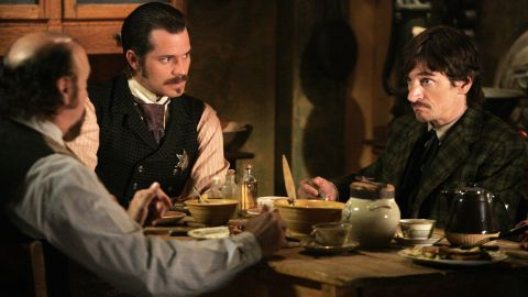 """Even with what many consider to be an unsatisfactory ending, Redditors agreed that HBO's """"Deadwood"""" is a prime candidate for binging thanks to its sharp writing and memorable characters. """"It's a slow burn of a show, but once you are hooked ... you ARE IN FOR LIFE. Or 3 seasons,"""" <a href=""""http://www.reddit.com/r/AskReddit/comments/2llwhe/what_television_series_is_so_good_its_worth_binge/clwanfz"""" target=""""_blank"""" target=""""_blank"""">one Redditor said</a>."""
