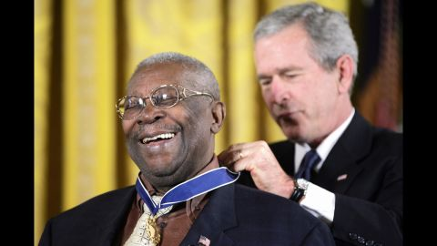 King smiles as President George W. Bush presents him with the Presidential Medal of Freedom during a White House ceremony in 2006.