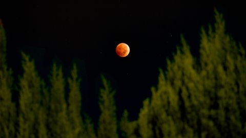 """<a href=""""http://ireport.cnn.com/docs/DOC-1177472"""">Paulo Solano</a> combined three different exposures using HDR photography to create this beautiful image from Van Nuys, California, of the October 2014 lunar eclipse. The second """"blood moon"""" of the year could be witnessed throughout North America, as well as over most of the Pacific and much of East  Asia."""