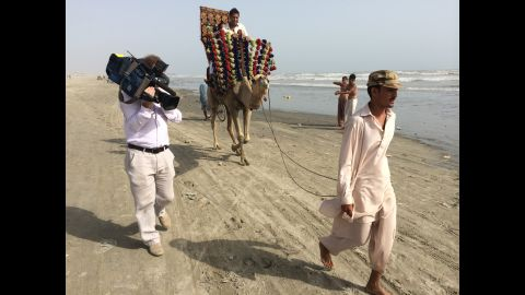 """CNN's Dr. Sanjay Gupta recently traveled to Pakistan, India and Michigan to trace his roots. """"A beach. A camel. Karachi. Three things I never imagined going together,"""" Gupta said. """"But it ended up becoming the beginning of our whole journey."""""""