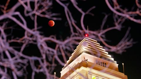 """There's a nice juxtaposition between the blood moon and a building in Los Angeles that made <a href=""""http://ireport.cnn.com/docs/DOC-1177348"""">Animesh Ray </a>wonder, """"Which is better?"""" """"Perhaps it is not our place to compare but only to contemplate their mutual synergy, one enhancing the other,"""" he said."""