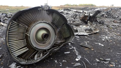 Debris from Malaysia Airlines Flight 17 sits in a field at the plane crash site in Hrabove, Ukraine, on Tuesday, September 9.