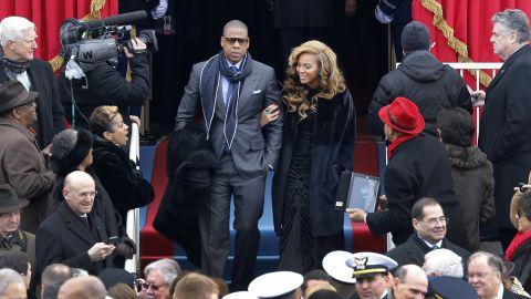 WASHINGTON, DC - JANUARY 21: Beyonce (R) and Jay-Z arrive at the ceremonial swearing-in for President Barack Obama at the U.S. Capitol during the 57th Presidential Inauguration on January 21, 2013 in Washington, DC.  U.S. President Barack Obama will be ceremonially sworn in for his second term today.  (Photo by Scott Andrews-Pool/Getty Images)