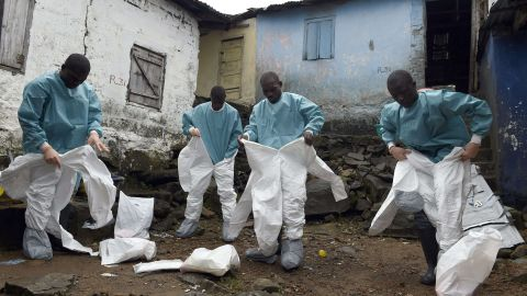 Medical staff members of the Croix Rouge NGO put on protective suits before collecting the corpse of a victim of Ebola, in Monrovia, on September 29, 2014. Of the four west African nations affected by the Ebola outbreak, Liberia has been hit the hardest, with 3,458 people infected -- more than half of the total number of cases. Of those, 1,830 have died, according to a WHO count released on September 27.