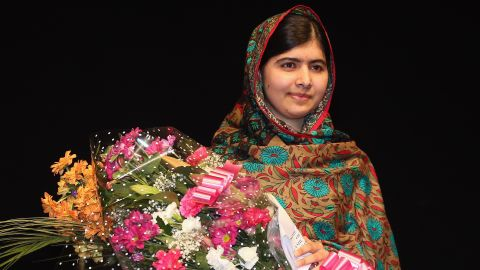 """Malala Yousafzai poses on stage in Birmingham, England, after she was announced as <a href=""""http://www.cnn.com/2014/10/10/world/europe/nobel-peace-prize/index.html"""">a recipient of the Nobel Peace Prize</a> on Friday, October 10, 2014. Two years earlier, she was shot in the head by the Taliban for her efforts to promote education for girls in Pakistan. Since then, after recovering from surgery, she has taken her campaign to the world stage."""