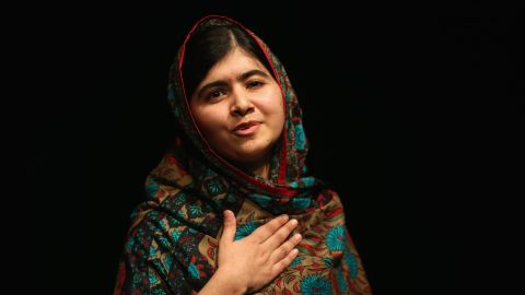 Malala Yousafzai acknowledges the crowd at a press conference at the Library of Birmingham after being announced as a recipient of the Nobel Peace Prize