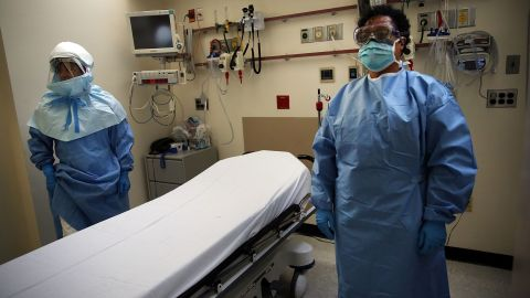 NEW YORK, NY - OCTOBER 08: Members of Bellevue Hospital staff wear protective clothing as they demonstrate how they would receive a suspected Ebola patient on October 8, 2014 in New York City. If the patient was confirmed to be carrying the deadly virus the person would be sent to an isolation unit for treatment. The first person diagnosed with Ebola in the United States, Liberian Thomas Duncan, has died at a Dallas hospital, Texas Health Presbyterian Hospital said. (Photo by Spencer Platt/Getty Images)