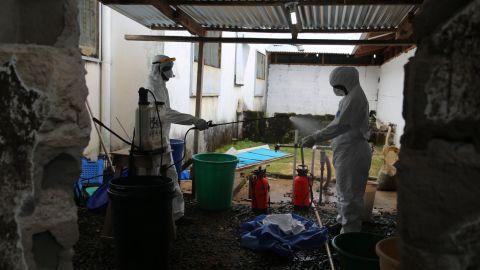 Health workers exit Monrovia's JFK Hospital's Ebola high-risk ward.