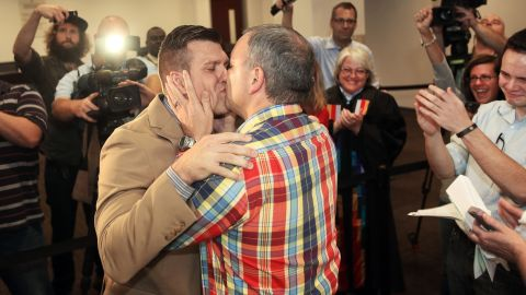 Chad Biggs, left, and Chris Creech say their wedding vows at the Wake County Courthouse in Raleigh, North Carolina, on October 10, 2014, after a federal judge ruled that same-sex marriage can begin in the state.