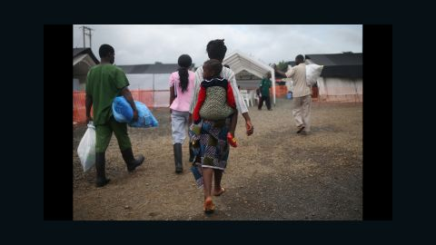 Ebola survivors prepare to leave a Doctors Without Borders treatment center after recovering from the virus in Paynesville, Liberia, on October 12, 2014.
