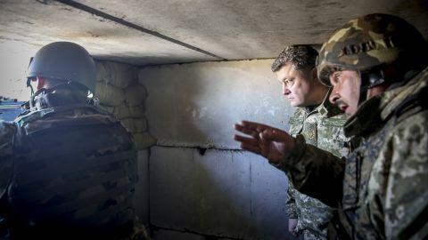 Ukrainian President Petro Poroshenko, center, inspects Ukrainian army positions close to Donetsk on Friday, October 10.