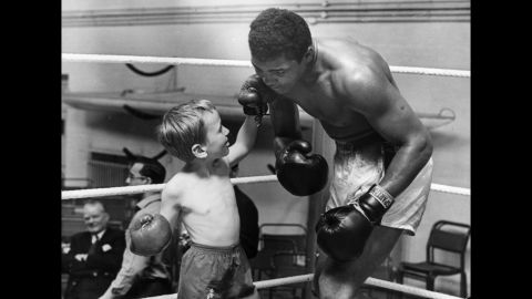 Patrick Power, 6, takes on Ali in the ring in 1963. Patrick was taking boxing lessons after getting bullied.