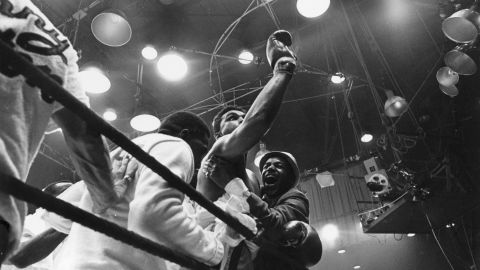 """Ali celebrates after defeating Liston in Miami on February 25, 1964. Upon becoming world heavyweight champion for the first time, Ali proclaimed, """"I am the greatest!"""""""