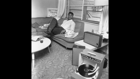 Ali relaxes after his win over Liston in 1964. At 22, he became the youngest boxer to take the heavyweight title from a reigning champion.