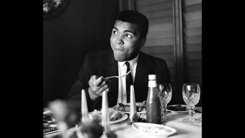 Ali eats at a restaurant in 1965.