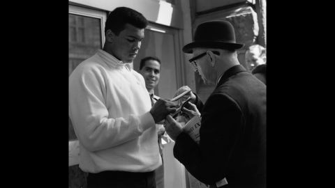 Ali signs an autograph for a fan in 1966.