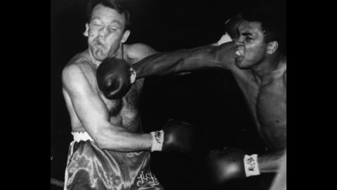 Ali lands a right to the head of Brian London during their bout in London on August 6, 1966. Ali won by a knockout in the third round.