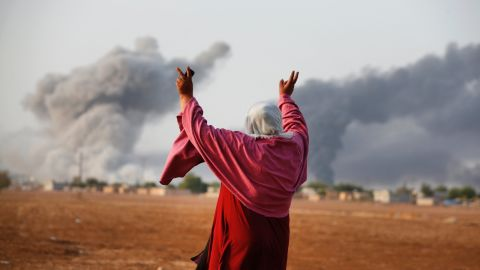 Kiymet Ergun, a Syrian Kurd, celebrates in Mursitpinar, Turkey, after an airstrike by the U.S.-led coalition in Kobani on Monday, October 13.