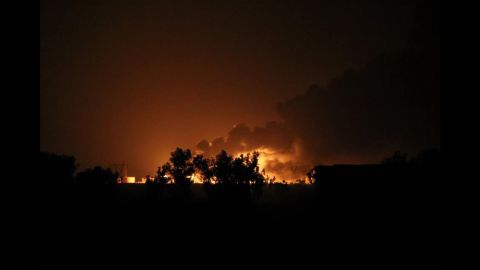 A Baiji oil refinery burns after an alleged ISIS attack in northern Selahaddin, Iraq, on Thursday, July 31.