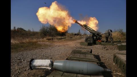 Pro-Russian rebels fire artillery toward Ukrainian position at Donetsk Sergey Prokofiev International Airport outskirts the city of Donetsk, eastern Ukraine Tuesday, Oct. 14, 2014. (AP Photo/Dmitry Lovetsky)