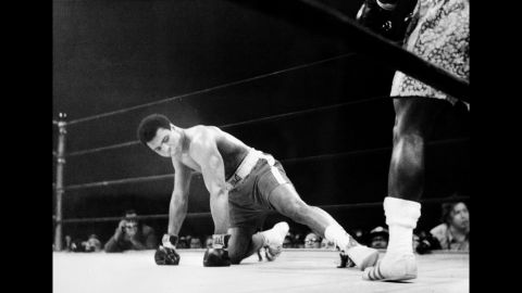 """Known as the """"Fight of the Century,"""" Ali and Joe Frazier split a $5 million purse to fight for Frazier's title on March 8, 1971, in New York. Frazier won by unanimous decision, handing Ali his first professional loss."""