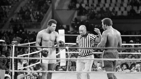 """Ali and Foreman fight October 30, 1974, in what was billed as <a href=""""http://www.cnn.com/2014/10/30/worldsport/gallery/rumble-in-the-jungle-40-years/index.html"""" target=""""_blank"""">""""The Rumble in the Jungle.""""</a> Ali, a huge underdog, knocked out Foreman in the eighth round to regain the title that was stripped from him in 1967."""