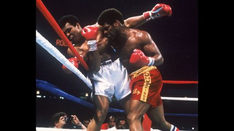 Ali takes a hit from Leon Spinks during their title fight in New Orleans on September 15, 1978. Ali won by unanimous decision, regaining the title he lost to Spinks earlier that year.