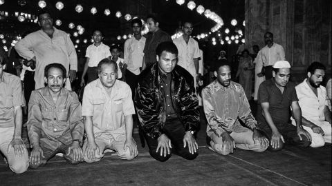 Ali prays at a mosque in Cairo in October 1986. Two years prior, he revealed that he had Parkinson's syndrome, a disorder of the central nervous system.