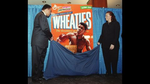 Ali and his fourth wife, Lonnie, unveil his special-edition Wheaties box in February 1999. The box marked the cereal's 75th anniversary, and it was the first time a boxer appeared on the cover.