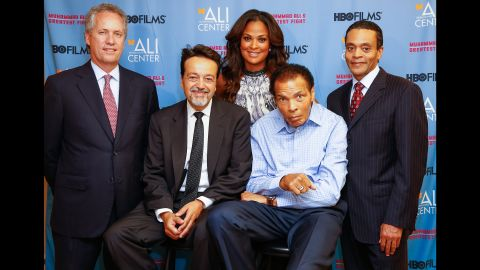 """Ali poses for a picture with, from left, Greg Fischer, Len Amato, daughter Laila Ali and Donald Lassere during the U.S. premiere of the HBO film """"Muhammad Ali's Greatest Fight"""" in October 2013."""