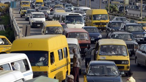 Motorists are stuck in traffic jam on October 13, 2014, tempting them to use their horns to hasten the flow of traffic in Lagos. October 15 has been declared Lagos' -- and Nigeria's -- first 'horn-free day', taking a cue from similar events around the world such as India's ear-splitting megacity Mumbai.The horn is the soundtrack to Lagos life and seen by many visitors as part of its vibrant charm as a hive of industry and entrepreneurial spirit.