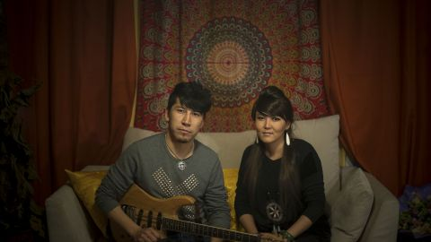 I'm Bayirta, and here's my wife Bayin. We're Mongolians from Xinjiang. I'm 30. I used to be guitarist and composer for a band and we won a national award in 2011. I just got married with Bayin this year, she was our back-up vocalist. We're preparing to set up our own band this year.