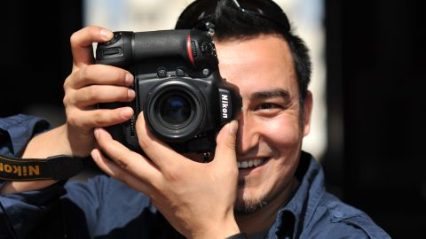 """Kurbanjan Samat, 32, is a cameraman and photographer. He started a project called """"I'm from Xinjiang"""" last December to take portraits of people from Xinjiang now living in other places. He's publishing a book of 100 stories selected from more than 500 people he spoke to."""
