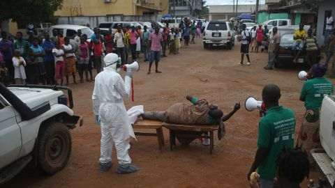Aid workers from the Liberian Medical Renaissance League stage an Ebola awareness event October 15, 2014, in Monrovia. The group performs street dramas throughout Monrovia to educate the public on Ebola symptoms and how to handle people who are infected with the virus.
