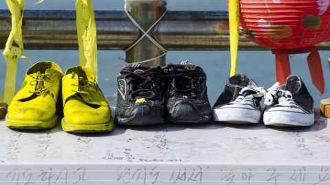 Shoes believed to belong to the missing and the deceased are on display at the harbor.
