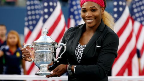 A more formally-attired Serena celebrates one of her six victories at the U.S. Open.