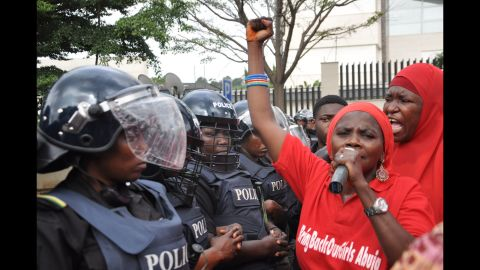 """Police in riot gear block a route in Abuja on October 14, 2014, during a demonstration calling on the Nigerian government to rescue schoolgirls kidnapped by Boko Haram. In April, more than <a href=""""http://www.cnn.com/2014/04/15/world/africa/nigeria-girls-abducted/"""">200 girls were abducted</a> from their boarding school in northeastern Nigeria, officials and witnesses said."""