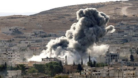 Heavy smoke rises following an airstrike by the US-led coalition aircraft in Kobani, Syria, during fighting between Syrian Kurds and the militants of Islamic State group, as seen from the outskirts of Suruc, on the Turkey-Syria border, October 15, 2014.
