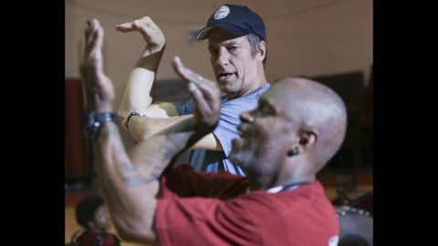 """Rowe learns the signature """"Marching Cobra"""" move from drum team leader Don Daughtry."""