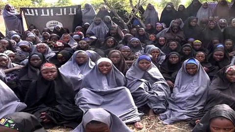 """A screengrab taken on May 12, 2014, from a video of Nigerian Islamist extremist group Boko Haram obtained by AFP shows girls, wearing the full-length hijab and praying in an undisclosed rural location. Boko Haram released a new video on claiming to show the missing Nigerian schoolgirls, alleging they had converted to Islam and would not be released until all militant prisoners were freed.  A total of 276 girls were abducted on April 14 from the northeastern town of Chibok, in Borno state, which has a sizeable Christian community. Some 223 are still missing. AFP PHOTO / BOKO HARAM  RESTRICTED TO EDITORIAL USE - MANDATORY CREDIT """"AFP PHOTO / BOKO HARAM"""" - NO MARKETING NO ADVERTISING CAMPAIGNS - DISTRIBUTED AS A SERVICE TO CLIENTSHO/AFP/Getty Images"""