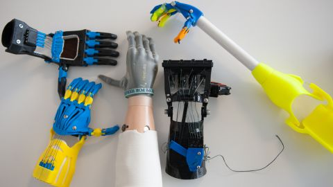 """The i-limb ultra (center) is a top-of-the-line electronic prosthetic that <a href=""""http://www.cnn.com/2013/02/01/tech/bionic-hand-ilimb-prosthetic/"""">costs $100,000</a>. Surrounding it are body-powered devices developed and built by a community of e-NABLE volunteers for roughly $150 a hand."""