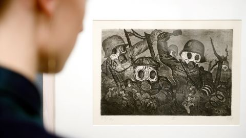 """Victorian imagery was inadequate to express World War I's anxieties, so new experiments took up the task, with artists incorporating aggressive imagery of combat and its ruinous consequences. Here a visitor to the Kunstmuseum in Stuttgart, Germany, examines Otto Dix's 1924 """"Storm Troopers Advancing Under Gas."""""""