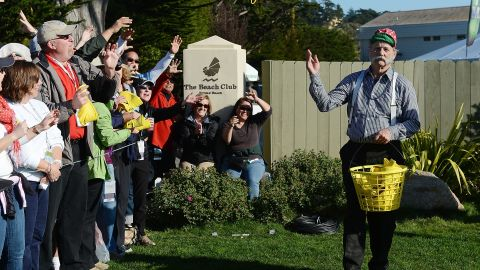 """Murray, an avid golfer, passes caps to fans on the 17th hole during the third round of the AT&T Pebble Beach National Pro-Am in 2013. He can often be found on a course -- if not <a href=""""http://www.theguardian.com/world/2007/aug/23/film.filmnews"""" target=""""_blank"""" target=""""_blank"""">driving a golf cart where it shouldn't go</a>."""