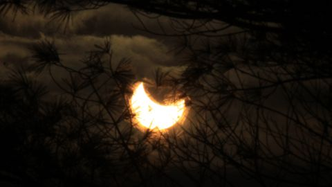 """""""Within a few minutes, the eclipsed sun appeared to dance in and out of the clouds, offering me some unique and magical views,"""" Mackenzie said."""