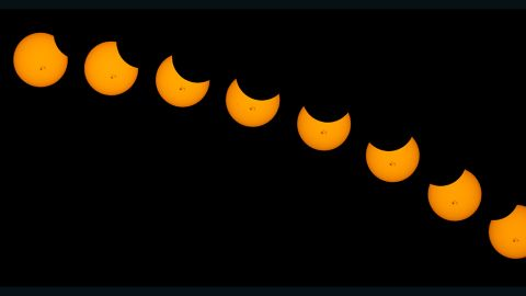 """The moon took a small bite out of the sun in a partial solar eclipse on Thursday. People throughout the U.S. shared their photos with <a href=""""http://ireport.cnn.com/topics/1309"""">CNN iReport</a>. Jim Steel created a <a href=""""http://ireport.cnn.com/docs/DOC-1182635"""">time-lapse composite</a> after snapping photos for more than two hours in Weldon, California. """"The massive sunspots made this the most interesting solar shots I have ever made,"""" he said."""