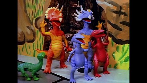 The miniature Dinosaur Family -- Dinosaur <em>was</em> their last name -- lived in the Playhouse wall, like mice.