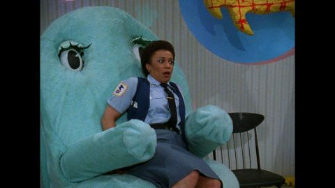 """Chairy envelopes Reba the mail lady (S. Epatha Merkerson of """"Law and Order"""" fame) in an embrace."""