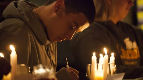 """Students from Marysville-Pilchuck High School write messages and prayers during a vigil Friday, October 24, at a church in Marysville, Washington. Earlier in the day, <a href=""""http://www.cnn.com/2014/10/27/us/washington-school-shooting/index.html"""">a student shot five people at the school</a> before he committed suicide, law enforcement officials told CNN."""