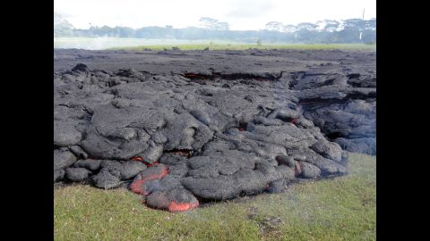 The horizontal incandescent cracks seen in the center and right portions of the photo, taken October 25, indicate that the flow was inflating: Fed by a continuing supply of lava beneath the cooling crust, the surface slowly rises.
